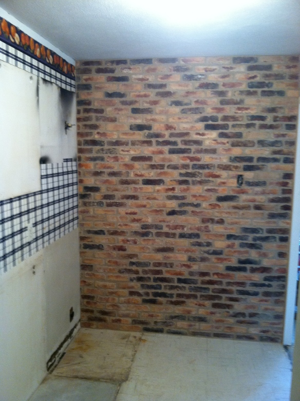 The Magpie was pleased with her idea to tile one of the kitchen walls in brick.