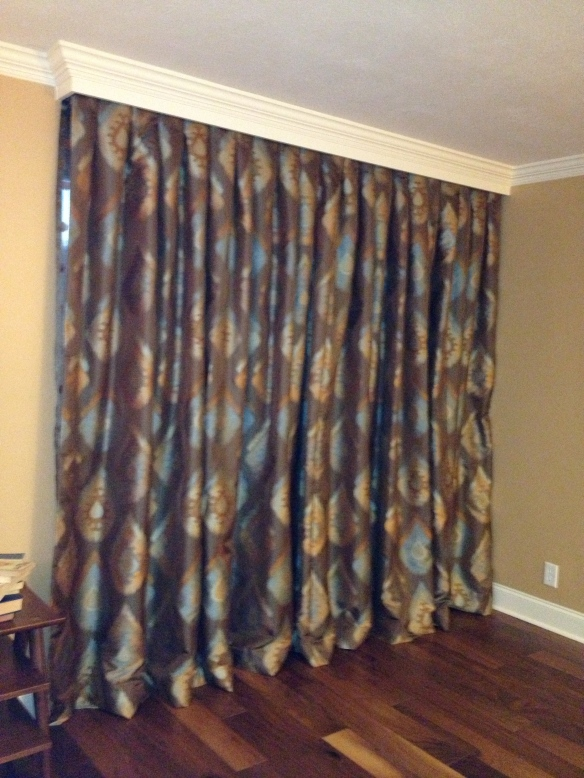 Drapes, a definite improvement over the vertical slat blinds.