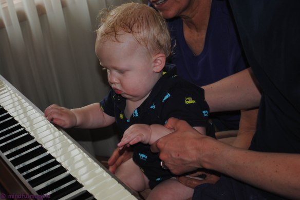 Playing the piano after his bath